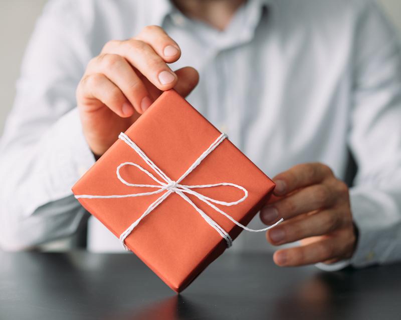 Man holding an orange gift box